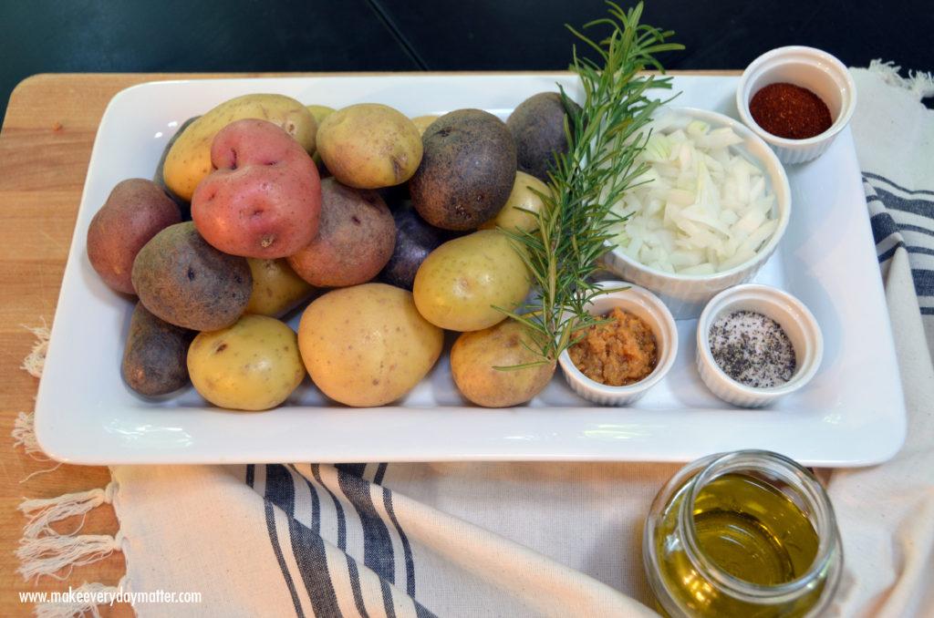 Rosemary potatoes on platter on cutting board watermark